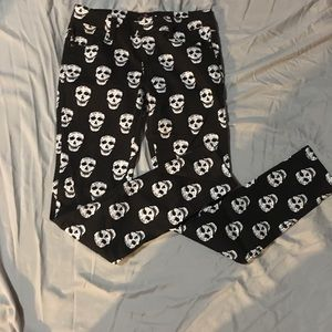 Black jeans with white skull heads .Stretchy